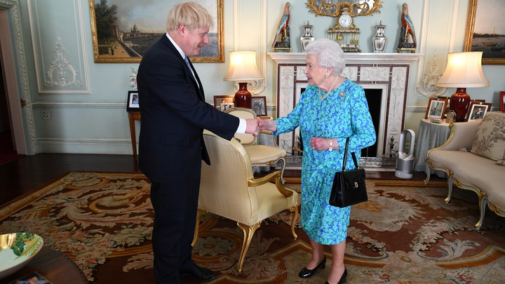 Boris Johnson shakes hands with Queen Elizabeth II in Buckingham Palace.