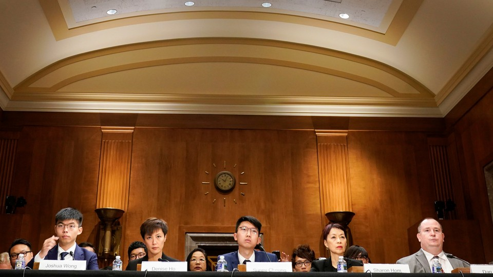 The Hong Kong pro-democracy campaigners Joshua Wong (far left) and Denise Ho (left) testify in Congress.