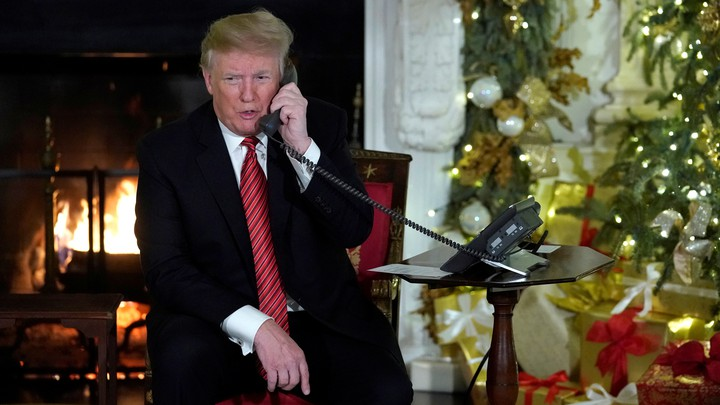Donald Trump on the phone in the White House