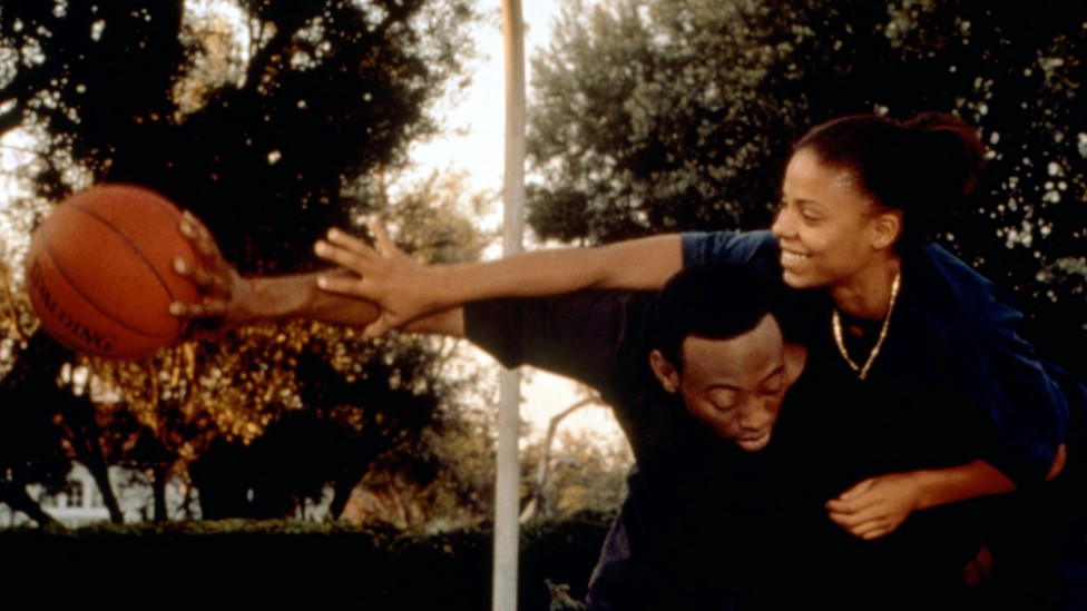 A still from the movie Love & Basketball with two characters playing one-on-one