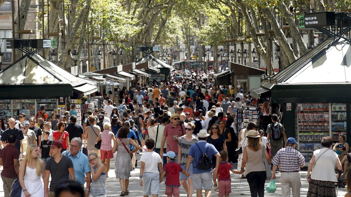 A crowd of people walks in Las Ramblas in Barcelona