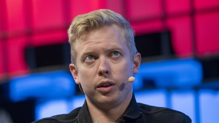 Steven Huffman speaks on stage at a conference.