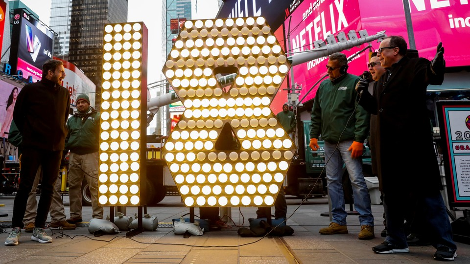 """The """"18"""" Numerals are turned on after being delivered to be placed atop 1 Times Square for the New Year's Eve ball drop."""
