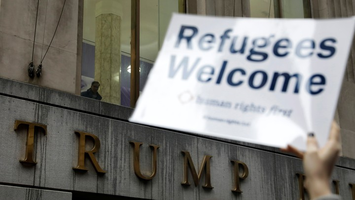 Protesters gather outside the Trump Building to take action against America's refugee ban.