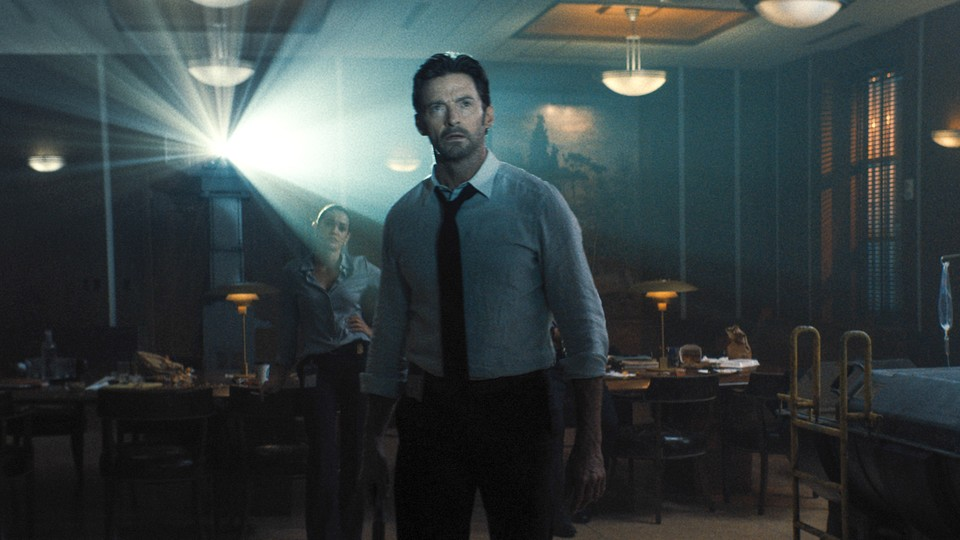 Hugh Jackman looking at a projection in 'Reminiscence'