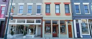 photo: A line of shuttered shops in downtown Cincinnati.