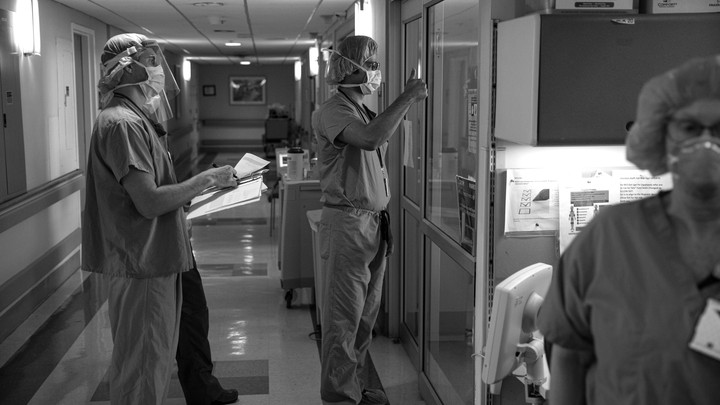A medical doctor gives the thumbs-up sign to a COVID-19 patient who is no longer using a respirator at the Veterans Affairs Medical Center in Brooklyn.