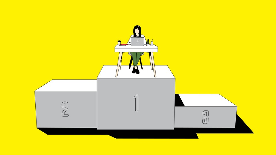 A woman works at her home office on a pedestal with three places.
