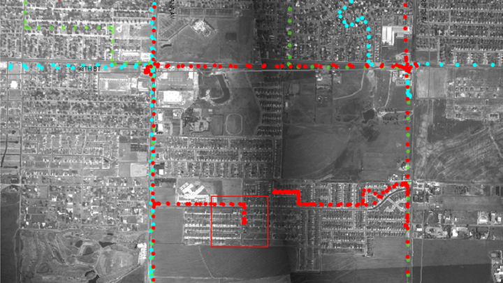 A town viewed from high above via aerial-surveillance camera