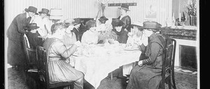 Women sit around a table drinking tea at the Hotel Roblin Paris in 1918.