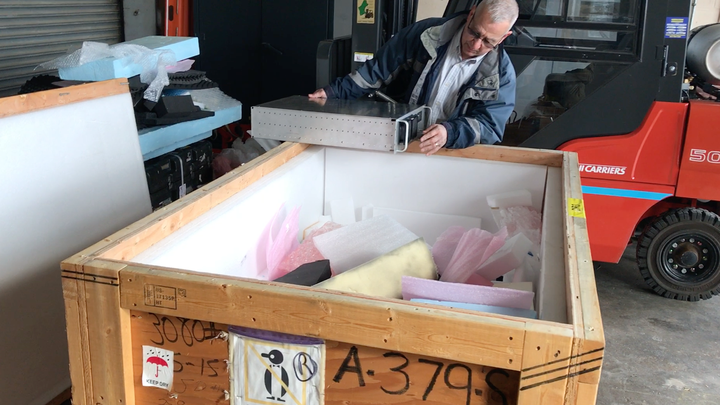 Shipping manager Don Sousa opens an important shipment from Antarctica.