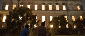 A crowd of onlookers watches fire consume the National Museum of Brazil in Rio de Janeiro on September 3.