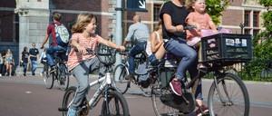 A mother and two children riding bikes in the Netherlands