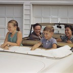 A family in a convertible