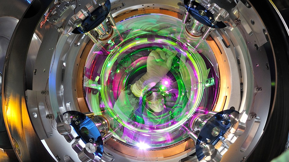 A scientist fiddles with the mirrors at LIGO.