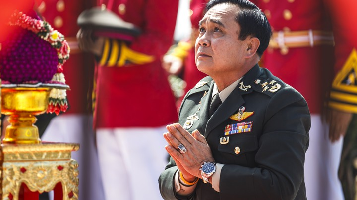 Prayuth Chan-ocha, the head of Thailand's military junta, prays at a military parade in 2014.