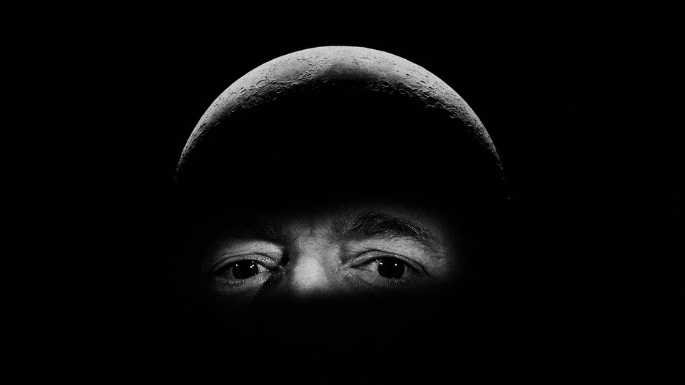A photograph of Jeff Bezos that has been edited to portray the billionaire's head as the surface of the moon