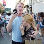 Onlookers in Barcelona in the aftermath of a fatal van attack.