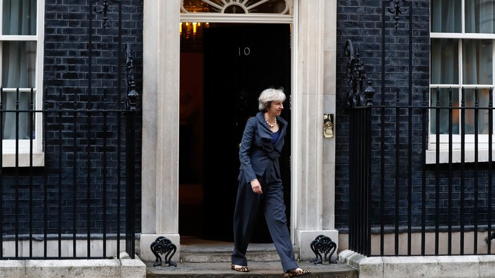 British Prime Minister Theresa May walks out of 10 Downing Street in London on September 22, 2016.