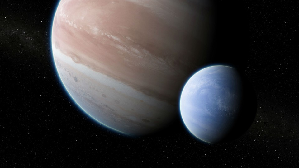 An artist's impression of the exoplanet Kepler-1625b with a large moon