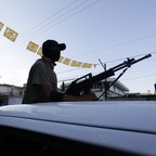 A community police officer patrols the streets in Guerrero, one of Mexico's most dangerous regions, in 2014.