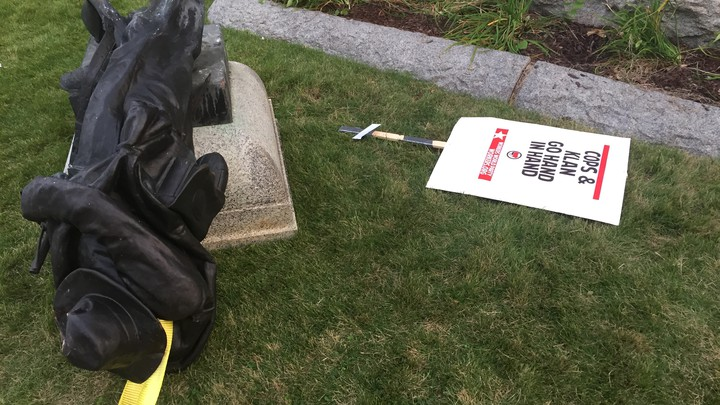 A Confederate statue in Durham, North Carolina, is taken down by protesters.