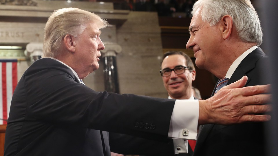 Donald Trump greets Treasury Secretary Steven Mnuchin and Secretary of State Rex Tillerson.