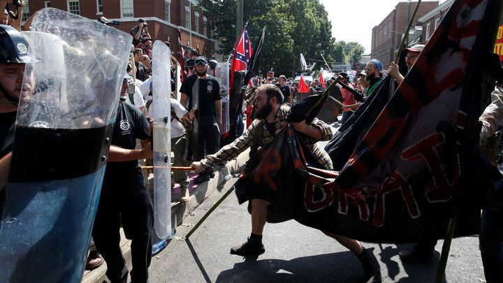 Members of white nationalist groups clash with counter-protesters in Charlottesville, Virginia