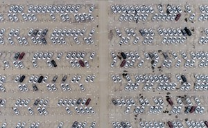 aerial photograph of thousands of parked cars