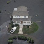 A home is surrounded by floodwaters from Hurricane Ike in Galveston, Texas September 13, 2008.