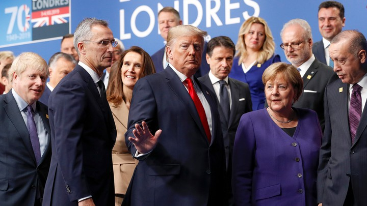 NATO Secretary General Jens Stoltenberg, U.S. President Donald Trump, Germany's Chancellor Angela Merkel, Turkey's President Recep Tayyip Erdogan and other NATO leaders leave the stage after family photo during the annual NATO heads of government summit near London.