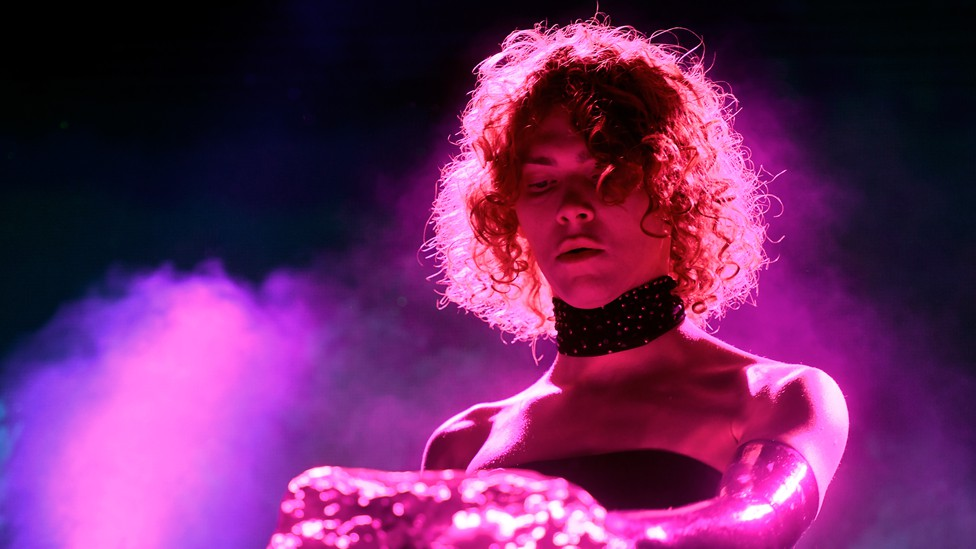 The late electronic producer Sophie bathed in pink light