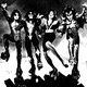 the band kiss dressed in futuristic costume
