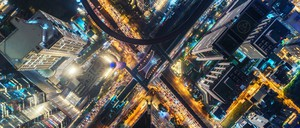 an aerial photo of urban traffic at night