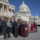 Dozens of members of Congress gather outside the Capitol building in Washington, D.C., for a press conference