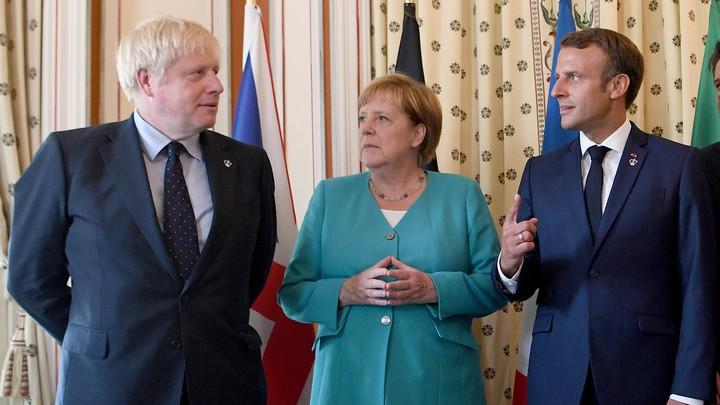 Boris Johnson, Angela Merkel, and Emmanuel Macron stare uneasily at one another.
