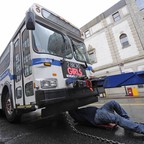 A tow truck operator hooks up a damaged bus in 2011 in New York.