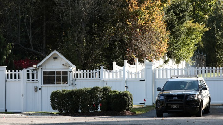 A car sits outside the home of Bill and Hillary Clinton in Chappaqua, New York.