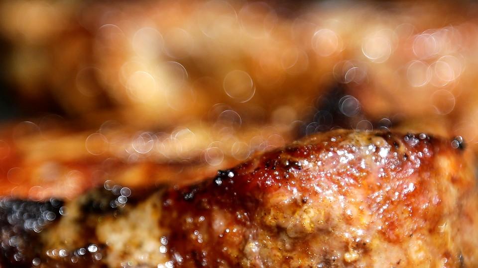 A close-up of a sizzling pork steak