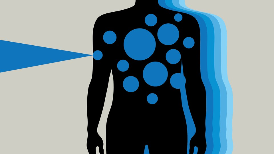 A silhouette of a person with blue spots