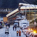 An Amtrak train on its maiden voyage from Seattle to Portland derailed above Interstate 5 on Monday.