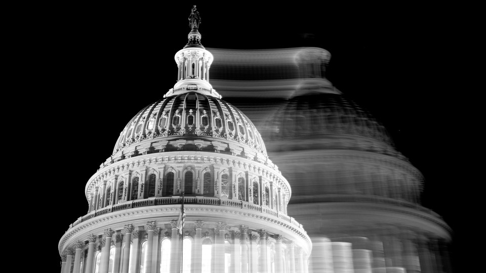 The Capitol is shown in black-and-white, with its blurry, shifted mirror image superimposed.
