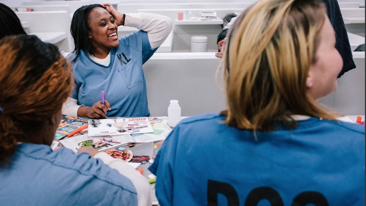 Bria Holloway, who is five weeks pregnant, attends a prenatal doula class held at Cook County Jail on November 13, 2019. The group meeting is every Wednesday. This session focused on making a vision board as well as a birth wish list.