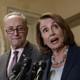 Senate Minority Leader Chuck Schumer and House Minority Leader Nancy Pelosi with microphones