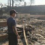 Richie Fredell, 38, a paramedic, looks at the remains of his childhood home in Ventura, California, on December 8, 2017.