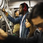 A commuter listens to music on headphones on New York City's MTA.