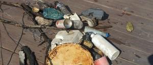 An assortment of plastic trash on a boardwalk.