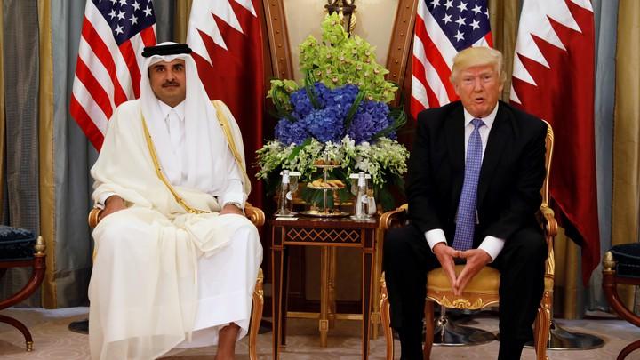 Qatar's Emir Sheikh Tamim Bin Hamad Al-Thani meets with President Donald Trump Saudi Arabia on May 21, 2017.