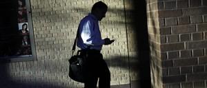 A businessman checks his phone in Charlotte, North Carolina.
