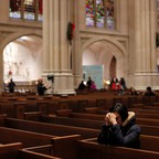 A woman prays in St. Patrick's Cathedral, one of the most prominent Roman Catholic churches in New York City